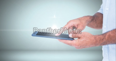 businessman touching tablet computer