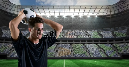 confident soccer player throwing ball on