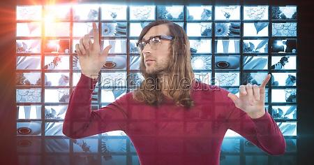 male hacker touching screen