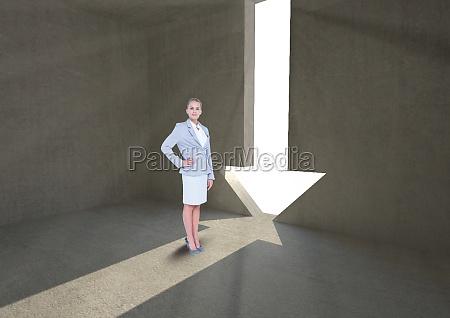 businesswoman standing by arrow shape doorway