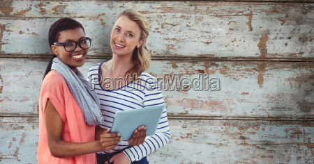 portrait of smiling businesswomen with digital