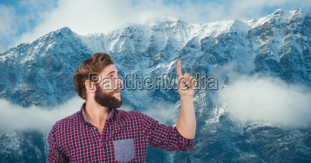 male hipster pointing against snow covered