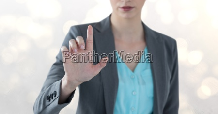 midsection of businesswoman touching imaginary screen