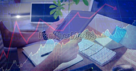 businessman holding digital tablet with overlay
