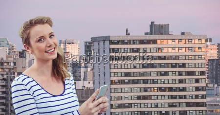 smiling woman holding mobile phone in