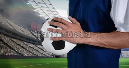 midsection of soccer player holding ball