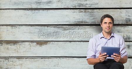 confident businessman holding digital tablet while
