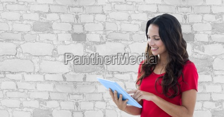 smiling woman using tablet pc against