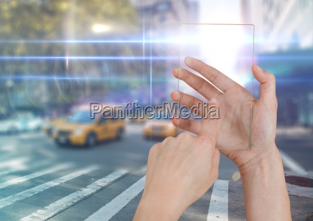 hand touching glass screen on city