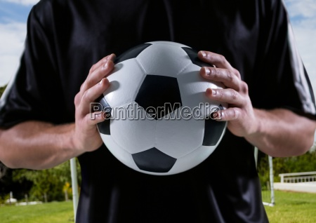 soccer player with ball in his