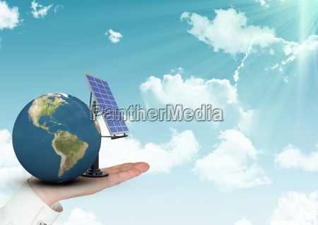 digital composite image of hand holding