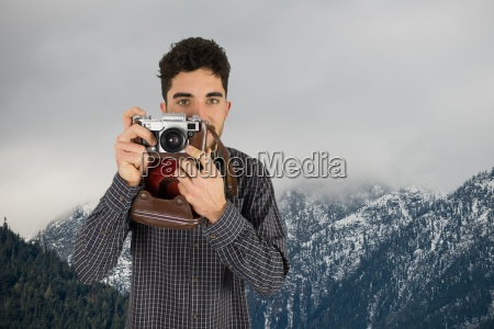 casual man taking a photo in