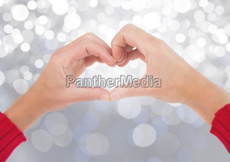 hands in heart shape with sparkling