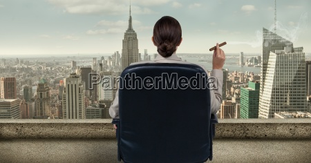 rear view of businesswoman sitting on