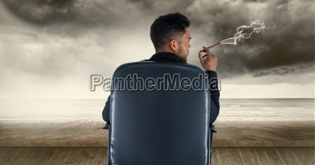 rear view of businessman smoking cigar