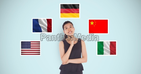 thoughtful businesswoman standing by various flags