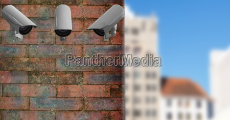 3 cctv on a brick wall