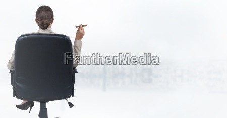 back of seated business woman smoking