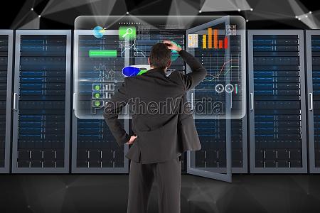 businessman is analyzing data against database