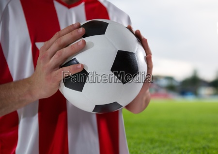 soccer player with the ball on