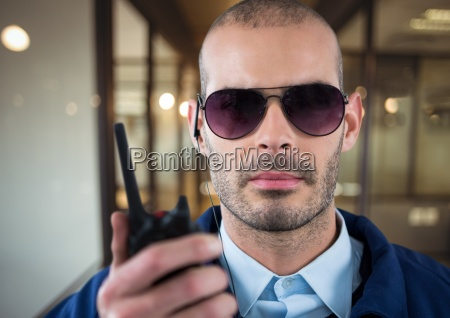 security guard with glasses headphone and