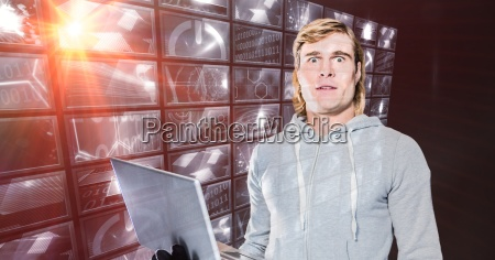 hacker holding laptop standing by digital