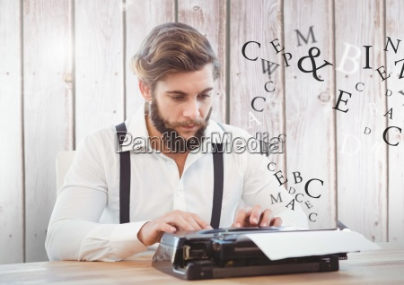 hipster man on typewriter with