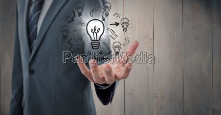 business man mid section with lightbulb