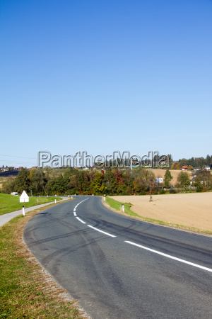asphalted country road with markings and