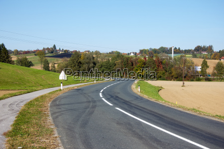 asphalted country road with markings without