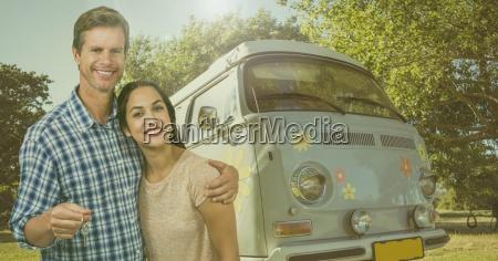 couple holding keys with camper van