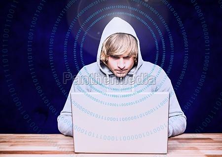 blond hair hacker using a laptop