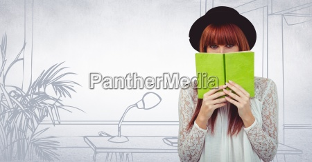 millennial woman with green book against