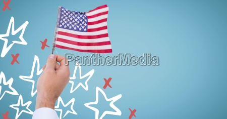 hand holding american flag against blue