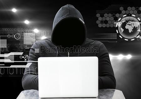 hacker using a laptop in front