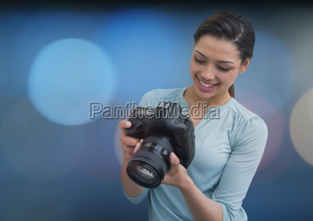 photographer smiling looking the photos on