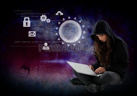 woman hacker using a laptop in