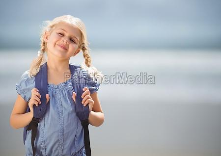 schoolgirl against blurry beach