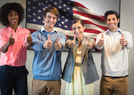colleagues with thumbs up against american