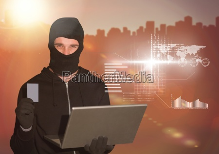 3d hacker holding a credit card