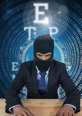 hacker using a laptop in