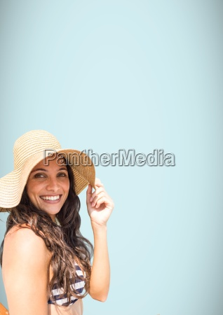 millennial woman sun hat and bikini
