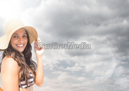 millennial woman in sun hat against