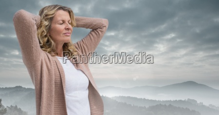 woman holding hands on head practicing