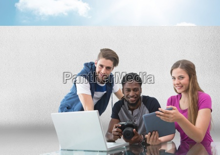 group of people on laptop with