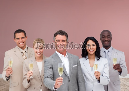 group of business people holding champagne