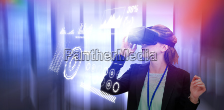 composite image of young businesswoman using