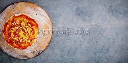 fresh pizza on wooden cutting board