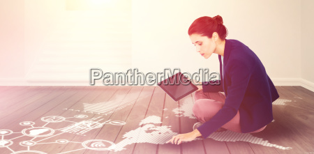 composite image of young businesswoman holding