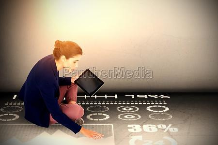 composite image of businesswoman holding digital